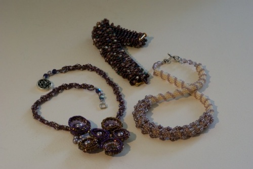 Intricate woven jewelry made of glass beads, pearls & crystals.